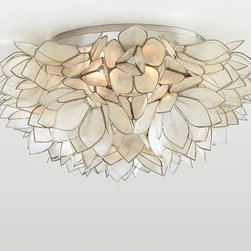 "Capiz Floral Flushmount - Hundreds of capiz petals form a luminous lotus flower on our flushmount fixture. The flower glows from within when the light is illuminated. 15"" diameter, 7.5"" high Handcrafted capiz petals with brass edges. Hand-applied polished nickel finish on iron base. Hardwire; professional installation recommended."