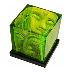 None - Green Glass Buddha Candle Holder - This beautiful candle holder is styled in a radiant green with faces of the Buddha on all four sides. This glass candle holder makes a functional and elegant addition to any decor.