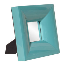 Howard Elliott - Howard Elliott Candy Teal Table Top Mirror - 9W x 9H in. - 78003 - Shop for Mirrors from Hayneedle.com! At first glance you might mistake the Candy Table Top Mirror - 9W x 12H in. for a modern picture frame but its contents are something more dazzling than a photo. Reflect ambient light by setting this on an accent table or use the piece to tend to your hair or make-up at a glance with this on your desk. Its frame is crafted from thick solid acrylic resin and is completed with a teal glossy lacquer finish. The mirror surface is smooth and without a bevel. An easel back supports this 10 lb. tabletop mirror.About the Howard Elliott CollectionThe Howard Elliott Collection is one of the premiere manufacturers of decorative mirrors and accessories in the home furnishings industry. Howard Elliott offers innovative designs in a wide variety of styles and the company prides itself on its high standards and quality. No matter your style the Howard Elliott Collection offers pieces that are sure to add sophistication and luxury to your decor.In the company's meteoric rise it now ships to nearly 3 500 furniture home furnishings and lighting retailers as well as many of the top contract companies servicing the hotel and building industries worldwide.