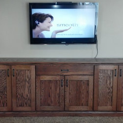 Custom Creations - Buffet style oak entertainment center.  Custom built for our client to use as storage and to ground the wall mounted television.