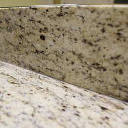 Master Bath Updates, Medina, OH #1 - We updated this bathroom by removing the original countertop, raising the vanity height and then installing a new countertop.  Giallo Ornamental 3cm Granite with ogee edge profile  with 2 undermount white rectangle 16x12' sinks where installed.