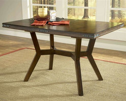 Hillsdale Furniture - Arbor Hill Extension Dining Table - Colonial chestnut color. Charm your guests with Hillsdale Furniture's Arbor Hill dining collection. Too modern to be country, but to rustic to be contemporary, with a classic mission styled chair and an unusual symmetrically sculpted table base, the Arbor Hill is a perfect blend of cozy and chic. Featuring a rich colonial chestnut finish, oil rubbed bronze decorative accents, versatile and comfortable brown leather waterfall seats and a butterfly leaf extension table, this ensemble will become the dining and entertainment center in your home. Composed of solid wood. Without leaf: 40 in. W x 60 in. L x 30 in. H. With leaf: 40 in. W x 78 in. L