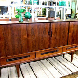 Credenzas - Rich rosewood exudes warmth and personality in this 1960s Danish sliding door credenza or sideboard.  So versatile it can be used in any room in the house, but today would be put to good use as a media console in a living or bedroom.