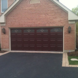 Various Installs - CHI 2752 Fiberglass insulated garage door with Brass Arched Somerst windows installed in Mundelein Call Overhead Garage Door at 1-888-459-3720.