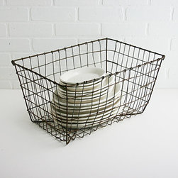 Vintage Industrial Wire Basket by Zinnia Cottage - Antique industrial style works really well with cottage style. A vintage wire basket like this one would look great storing everything from a stack of tea towels to a collection of old paperbacks.