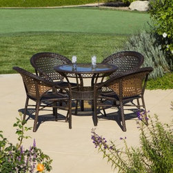 All-Weather Wicker Patio Dining Set - Set of 4 - We're not recommending that you wait until next year to enjoy the All-Weather Wicker Patio Dining Set - Set of 4, but even if you did, this durable and charming set would look and feel just as good while it waited patiently for you on the patio or porch. The curved, fan-back chairs and charming table are crafted from resin wicker over lightweight metal frames. This innovative design gives you the classic curves and style that you expect from wicker, with the added bonus of superior resistance to rot, cracking and weathering. The circular table features an inset of tempered glass, giving you a low-maintenance and appealing table top. About Best Selling Home Decor Furniture LLC Best Selling Home Decor Furniture LLC is a US-based company dedicated to providing you with a wide variety of fine furniture. With sales and manufacturing offices in Europe and China, as well as the ability to ship to anywhere in the world, no one is excluded from bringing these lovely pieces home. From outdoor to indoor furniture, children's furniture to ottomans and home accessories, all your needs will be met with attractive, high quality products that will last.