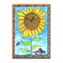 Sunflower Wall Clock - The Sunflower Clock is perfect in any room, and is a favorite for the kitchen. It's hand made in our studio, from a print of an original watercolor which is dry mounted onto black foam board and heat-sealed with a protective laminate. It's so light it can be hung on a pushpin, has a hanger on the back and comes in a gift box. The quartz movement runs on a single AA battery. (Be sure to look for our sunflower night light, too!)