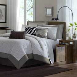 """Madison Park - Sasha 7 Piece Jacquard Comforter Set in Gray - Get in touch with your wild side and relax with the Sasha bedding collection. A very subtle zebra pattern is woven in a tonal gray color way, with a darker gray solid border. Bedskirt color is brown. Features: -Available in Queen, King or California King sizes. -Set includes an oversized and over-filled comforter, two shams, a bed skirt and three accent pillows (18""""x18"""" square, 16""""x16"""" square and 12""""x20"""" oblong). -Material: 100% Polyester. -Color: Gray. -Very subtle zebra pattern is woven in a tonal grey color way, with a darker gray solid boarder. -Dimensions: 90""""-104"""" Height x 90""""-92"""" Width."""