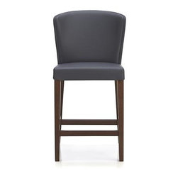 """Curran 24"""" Grey Bar Stool - Sleek Italian design cradles comfort in beautiful curves and fashion-forward grey. Rich pebble-textured leather alternative hugs subtly angled wing back and seat with the look and feel of the real thing, with the added bonus of easy care and exceptional durability. Self-welt details accent the elegant lines, while slender solid beech legs finished in walnut add warm contrast. Available in two heights for kitchen island, work table or bar seating."""