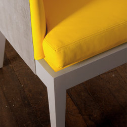 Spring 13 - Artisan upholstered with Berkshire Sunburst Yellow leather interior and Houndstooth Stormy exterior with grey baseball stitch detail. Features a hand applied Revere Pewter finish on exposed maple legs. For suggested finishes and fabrics see Custom Tailoring section below.