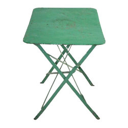 Pre-owned French Iron Cafe Iron Table in Green - Circa 1920, this wonderful French iron cafe table works well for both interiors and gardens. It folds flat. This piece was brought from France to California in the 1970's.