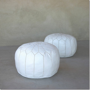 Moroccan Leather Pouf - Striking low pouf in durable white leather handmade in Marrakech, featuring traditional Islamic embroidery patterns. These fun low poufs are great as footstools or as extra seating and their densely packed shredded fabric filling will not collapse when you sit on them!