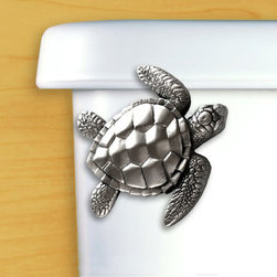 Sea Turtle Toilet Handle - Sea Turtles have figured prominently in mythology and fork lore within many cultures. Help keep this species from becoming endangered by adding this fascinating ancient creature to your protected environment. Delightfully detailed in Satin Pewter.