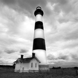 Bodie Island Lighthouse - Bold and beautiful, the Bodie Island Lighthouse embodies the history of maritime. This limited edition, black and white photo, taken by photographer Thurston Howes, becomes a beacon of its own hanging in your home.