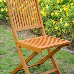 International Caravan - International Caravan Royal Tahiti Folding Chairs (Set of 2) - The durable folding dining chairs by Royal Tahiti come in a set of two chairs crafted from yellow Balau wood. The folding chairs can easily be closed and stored when not in use. Balau wood is very durable,dense and oil-rich so is safe for use outdoors.