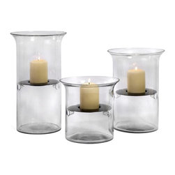 IMAX Worldwide Home - Glass and Iron T-Lite Holders - Set of 3 - Whimsical clear glass set of three tea light holders in graduated sizes.   Candles appears to float suspended in the glass vases. Candleholders. 8.5-12.25-15.25 in. H x 8.75 in. D. 90 % Glass, 10% Iron