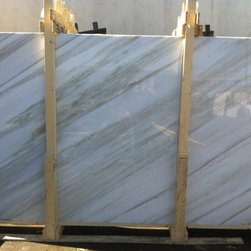 Calacatta Crema Marble Slabs from Royal Stone & Tile - Sophisticated and classic are just a two words to describe Calacatta Crema marble. Characterized by a white background with gray and cream veining. This elegant natural stone makes any project a one of a kind. Ideal for countertops and wall cladding.