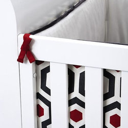 """Home Decorators Collection - Quinn Crib Bedding - Add geometric flair and cool color to your nursery with our Quinn Crib Bedding. The outer Crib Bumper is ivory pique; the inside features a geometric honeycomb pattern in slate grey and red. With elastic all around, the solid color, slate grey Crib Sheet will hug your crib mattress securely. The tailored Crib Skirt features the same honeycomb pattern as the inside of the bumper. These three items can be purchased individually or as a set. Each item fits a standard 52"""" x 28"""" crib. Three-Piece Crib Set includes Bumper, Sheet and Skirt. Bumper and Skirt are 100% polyester. Sheet is 100% cotton. Bumper includes polyester fill insert. Spot or dry clean the Crib Bumper and Skirt. Sheet is machine washable. Part of the Quinn Nursery Collection. In accordance with city and state laws, Home Decorators Collection does not sell baby bumpers to consumers living in Maryland or Illinois."""