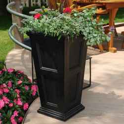 Mayne - Mayne Fairfield Tall Patio Planter - 5829W - Shop for Planters and Pottery from Hayneedle.com! Bring the classic charm of New England to your porch or deck with the Mayne Fairfield Tall Patio Planter. Crafted from high grade polyethylene for long-lasting durability and quality these planters are designed to have the beautiful look of real wood. Each planter comes with a self-watering tray insert that creates a built-in reservoir encouraging healthy root growth by allowing the plant to almost water itself. Each planter comes in your choice of black clay or white and has a limited 15-year manufacturer's warranty.How does the Sub-Irrigation Water Reservoir work? These patio planters include a trough design creating a sub-irrigation water reservoir at the bottom of the planter. Capillary action allows water in the reservoir to soak upward keeping the soil and plant roots moist. To avoid oversaturation an overflow hole is drilled through the outside wall allowing excess water to drain out from the planter. Regular watering is required for the first few weeks giving the root system time to develop. Once the roots have grown down to the troughs the plants will be able to pull moisture from the reservoir creating a self-watering effect.About MayneSince its conception in 2005 Mayne Mail Posts has grown and expanded its line of distinct outdoor products. Based in London Ontario Mayne takes great pride in creating and designing high-quality products for your home including mail box posts planters address signs and lamp posts. Mayne's dedicated team continues to set high standards in order to provide you with service and quality worthy of remembering.