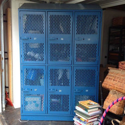"Large Blue Metal Storage Locker - It's time for PE! We LOVE this awesome industrial vented all metal sports locker with original blue paint. Each set of 2 (top and bottom) are numbered consecutively: 25, 26, and 27. There are 4 hooks in each of the 6 lockers. They have heavy lever handles which have holes for locks. The open grating on the doors is heavier than the grates on the side of the locker. The backside is solid.  The locker itself measures 7' high x 54"" wide, and is 16"" deep. There are actually 6 individual lockers, measuring 17"" wide x 16"" deep and 35"" high. As you can see in the photos, the top is slanted which makes the face height 76"". The slant measures 17.5"". It is in excellent shape and the sky is the limit as far as its potential uses. Add it to an entry hall or mudroom for sturdy storage. Or even use it a kitchen for extra pantry space."