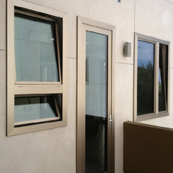 Temecula Contemporary - Contemporary stainless steel exterior, with solid walnut interior. German turn and tilt hardware and spectrally selective coating. 25% more argon gas, low-e advanced coating, and 4 full gaskets.