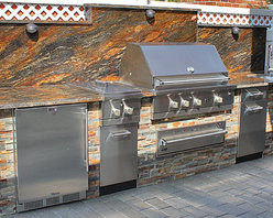 "Viking Outdoor Kitchen - Viking Outdoor Kitchen featuring 42"" 500 Series Gas Grill with warming drawer, double side burner, trash cabinet, sink & faucet, access door, & TRUE refrigerator. Stone veneer with granite countertop & back splash - Supplied & Installed by NYC Fireplaces & Outdoor Kitchens of Maspeth, NY."