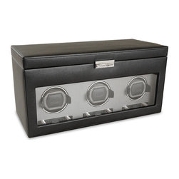 Frontgate - Triple Watch Winder with Storage - Enlarged drum easily holds the largest of timepieces. Backlit LCD display lights up with your touch. You select turns per day, from 300 to 1200 in increments of 50. Easy directional control clockwise, counterclockwise, or bi-directional. Power reserve start delay from 6 to 72 hours (in increments of 6 hrs.). Our Viceroy Watch Winders simulate wrist action, rotating the watch as if it were being worn, and keeping it wound and ready to wear at a moment's notice. The sophisticated appearance of this winder includes a supple black pebble textured outer finish, gray textured silk faceplate, chrome hardware, and recessed metal hinges. . . . . . Rotation countdown display shows where your winder is in its cycle. Sturdy wooden frame. Metal hinges are recessed with integrated 90 degrees lid stoppers. Lockable glass front cover. Operates with 3.3V adapter (included) or D batteries.