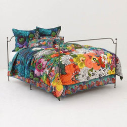 Lush Landscape Quilt - Anthropologie.com - Anthropologie is the master when it comes to bold colors and patterns and mixing pattern on top of pattern.  I've long saved up to buy one of their bedding outfits, because every time I go into a store, I just want to fall into their beds!  This one has such bright and joyful colors...it feels like you've fallen asleep in a field amongst the flowers!