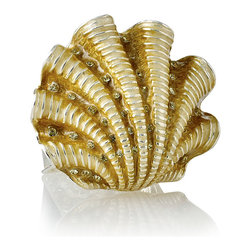 Ivory Coast Shell Napkin Ring - Gold - Set of 4 - Enamel, crystal, and finely-textured metal come together to shape the fan of a scallop shell in the Ivory Coast Shell Napkin Ring. Tinted a creamy gold by the enamel work, this Versailles-worthy transitional jewel is studded with points of light where rhinestones glimmer within the shell's channel; use with glamorous crystal ware or golden flatware for a luxe look. This item is sold as a set of four.