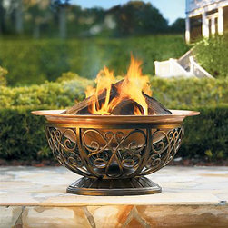 Outdoor Copper Fire Pit - I love the scrolled iron base of this firepit. Having the fire up off the ground seems to make it a bit safer for a fire area on a large deck. Its' wide base also makes it more stable. I have a copper pit right now and love the patina the copper has taken on over the years.