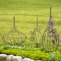 Topiary Garden Forms - Using a topiary is a great way to add interest and height to the garden. I like these because they have an artistic look to them even when they're not filled out.