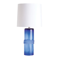 Topher Cobalt Irregular Banded Glass Lamp - Deep, classic cobalt blue is at home in oceanic-themed rooms and in traditional decor, but the design of the Topher Cobalt Glass Lamp has a distinct transitional edge.  The saturated cool sapphire of the glass gives a subtle ombre effect in the clear, polished cylinder of the base, in addition to coloring the frosty irregular ring that girdles it.  The Topher table lamp is available in several colors, each equipped with an iconic white shade.