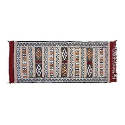 """Pre-owned Blue and Red Moroccan Berber Kilim Rug 1'8""""x4'1"""" - This one-of-a-kind 4'1"""" x 1'8"""" Moroccan handwoven Berber kilim rug in blue and red has intricate geometric shapes and symbols. It's the perfect piece to spice up your Mid-Century Modern decor, roll it out and watch the compliments file in."""