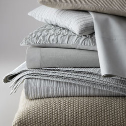 "Donna Karan Home - Donna Karan Home Two Standard/Queen Pillowcases - Donna Karan Home's ""Urban Oasis"" bed linens collection provides subtle texture in equally subtle colors. Select color when ordering. Moire jacquard linens with 7"" flange are made of cotton. Quilted accessories with linear stitching are cotton voile....."