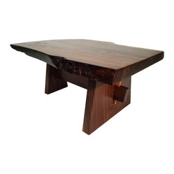 Hand crafted by Laurens Cotten - Live Edge Coffee Table - inspired by George Nakashima - This live edge coffee table began with a beautiful slab of walnut which was chainsaw cut from the root section of an old growth tree that had been lost in a storm. Afterwards it sat in a barn, gaining character with each passing year.