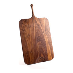 De JONG & Co. - Serving Board No.7 - Hand-shaped black walnut. Leather hanging loop. Hand-carved cutout. Food safe. Fully seasoned with walnut oil and wax finish. Products are made to order which can result in longer lead times.