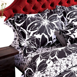 koi Design - Midnight In the Garden Duvet Set - Cozy up to the idea of graphic black and white hues in the bedroom with a burst of botanicals that soften up this contemporary duvet set made of sumptuous sateen cotton. Pair the classic color combo with a vibrantly colored headboard or add drama to your boudoir with black shades for the bedside lamps.
