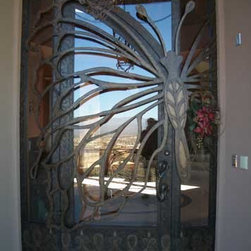 Glass Butterfly Door - This has to be one of the most unique front doors I have ever seen. The butterfly is incorporated into the entire structure, providing beauty and security.