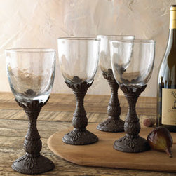 """GG Collection - GG Collection Four Wine Glasses - Clear glass wine glasses rest on cast aluminum stems. Not dishwasher safe; hand wash with mild soap and warm water only. Each 8-ounce glass is 9""""T. From the GG Collection. Imported."""