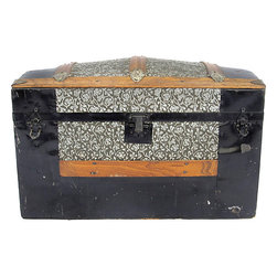 Consigned Antique Dome Top Trunk - Gorgeous dome-top trunk with Art Nouveau pressed-tin floral inserts and a floral wallpaper-lined interior. Black tin, wood slats, and hardware adorn and protect the exterior. Original latches. Handle missing on left side, but hardware remains for replacement. Tiny wheels embedded in the wood slat base.