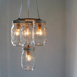 "Mason Jar Chandelier by Boots N Gus - I wouldn't normally connect ""cabin"" with ""chandelier."" But in this case, a chandelier made with vintage canning jars, I think this handmade light fixture is a perfect fit for that cabin style."