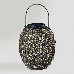 World Market - Twist Solar Outdoor Lantern - Elevate the style of your outdoor lounging area with our handsome Twist Solar Outdoor Lantern. Featuring a natural-looking entwined rattan shade, this rustic lantern is solar-powered and includes a rechargeable battery for earth-conscious style.