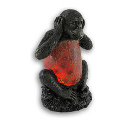 """Zeckos - """"Hear No Evil"""" Monkey Crackle Glass Accent Lamp - This incredibly cute Hear No Evil monkey accent lamp makes a fun gift for friends and family, with the top and bottom of the monkey being made of cold cast resin, and his belly is made of epoxy set crackled glass to give off soft orange light. The lamp is 9 inches tall, 5 1/2 inches long and 5 inches deep, making it a perfect accent for end tables and nightstands. It takes one nightlight style bulb (included), and the bulb is easy to replace. It comes with a 6 foot light cord, containing the on/off switch. It's a perfect gift for any monkey lover."""