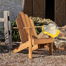 Southern Enterprises - Soleil Teak Adirondack Chair - Teak offers elegance, durability, and resistance to the elements. Classic Adirondack chair style. Light brown unstained teak finish. Seat: 20 in. W x 19 in. D x 14.75 in. H. Arm height: 23.75 in. H; under chair: 8 in. H. Max weight capacity: 250 lb.. Constructed of 100% teakwood. Assembly required. Overall Dimensions: 33 in. D x 28 in. W x 37.5 in. H (29 lbs)Take a moment to unwind in this beautiful take on the classic outdoor seat. This elegant and comfortable Adirondack chair is a masterpiece of outdoor furniture. The angled back and curved top pair with the warm, unstained teak finish to add beauty and comfort to your outdoor living space. The classic flat arms offer relaxation or a convenient place to set a drink. Teak naturally weathers over time to a handsome, silvery gray color if kept outdoors; regular application of teak oil will maintain the light brown color of the wood. Simply clean the wood with mild soap and water when necessary.This classic style of this chair is perfect for outdoor or patio use and lends to rustic decor. The durable teak wood will provide handsome use through the years.