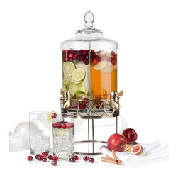 Colin Cowie Dual-spigot Beverage Server with Metal Base - I think this Colin Cowie dual-spigot beverage server is an ingenious idea. The glass is partitioned into two parts and includes two separate spigots, making it easy for you to serve two different beverages in one attractive container.