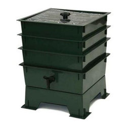 "The Worm Factory® 3-Tray Recycled Plastic Worm Composter - Green - What is The Worm Factory 3-Tray Recycled Plastic Worm Composter - Green and how does it work?This green 3-tray worm composter is a multi-tray compost system that helps manage the composting process and provides you with nutrient-rich compost for your garden. It's easy to set up and simple to use. Fill each stacking tray with kitchen scraps such as newspaper junk mail vegetables fruits egg shells coffee grounds paper and cardboard into nutrient-rich compost for your garden. Most """"Master Gardeners"""" consider worm castings to be the very best compost available. Your plants will thrive with this all-natural compost. Sorting out the undigested scraps can be a messy inconvenient chore with ordinary worm composters. Worms start in the bottom tray and migrate upward as they break down the waste. This allows worms to separate themselves from the finished compost making it easy to add nutrient-rich fertilizer to plants and gardens without sorting worms. Additionally nutrient-rich moisture is captured in the collection tray and can be drained as liquid fertilizer known as """"worm tea"""". What are the benefits of using The Worm Factory? The Worm Factory is Compact: With its square design and having the smallest footprint of all the worm composters The Worm Factory 3-Tray Worm Composter - Green works great for anyone with space requirements. The Worm Factory uses a tray stacking system which allows it to hold the largest capacity of compost in the smallest amount of space. The Worm Factory is Odorless: The ventilation lid allows proper air flow and the instruction manual helps you manage The Worm Factory correctly to prevent odor. This means that it can be used year round and can be housed anywhere including apartments kitchens garages porches etc. The Worm Factory is Easy to Manage: The 16-page instruction manual makes the setup process fast and easy and gives detailed instructions on how manage the bin year round. Each tray holds 12.5 pounds of compost which makes lifting and arranging trays effortless. The ventilation lid also contains a list of composting tips for quick reference. The Worm Factory Saves Time: Let The Worm Factory do the work for you! Instead of spending time turning piles of compost yourself and removing worms by hand the multi-tray system separates the worms from the compost so you don't have to. Also because the worms continually eat through your kitchen scraps and junk mail nutrient-rich compost is produced at a faster rate than traditional ways of composting. In full operation the Worm Factory houses 6 000 worms consumes 5 to 8 pounds of food a week allowing you to harvest a full tray of nutrient-rich castings every month. This allows you to bring rich dark compost to your plants and gardens at a faster rate."