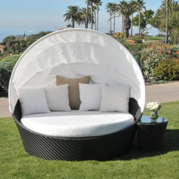 Caluco Maxime All-Weather Wicker Daybed Set with Canopy - As the weather turns warm you want to live out in your backyard and with the Caluco Maxime All-Weather Wicker Daybed Set with Canopy you almost can. You don't have to sacrifice a beautiful day by going inside when the warm sweet summer air makes you drowsy. Keep enjoying it as you lounge in your patio daybed. The shade of the canopy will ensure that you stay perfectly comfortable and the side table will allow you to keep a cool beverage close at hand. The Maxime collection by Caluco uses durable commercial-grade construction on welded frames with premium quality extruded aluminum. With all the exotic appeal of fine rattan but without the upkeep its hand-woven resin wicker is made from innovative weather-repellant polyethylene strands that are highly resistant to fading cracking and mildew. The soft cushions and the rich dark java finish carry the look of resort-style luxury which you can then tailor to your own tastes with a wide variety of fabric colors and patterns. About CalucoCaluco Patio Furniture is a direct importer of high-end outdoor patio furniture. They specialize in providing Grade A aluminum teak and wicker furniture expertly manufactured and sold to you at affordable prices. Their outdoor patio furniture is shipped directly to their 40 000 square foot facility in San Fernando California; and from their facility they ship it directly to you. Their clients choose them for their expertise and their ability to combine high end quality with customer care without the high-end pricing.