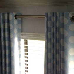 Drapery Ideas - This is the appropriate way to handle almost any bay window configuration.  There is an elbow joint connecting the poles, creating the look of one continuous rod.
