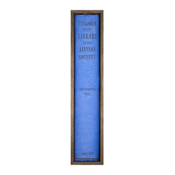 The Book Collection: London - Framed Print - The vivid cerulean blue of The Book Collection: London means the print catches the eye and serves remarkably well to create a strong geometric point in your decor. It might take a moment to understand the full impact of the print, which simply reproduces the spine of a forgotten library volume at several feet high. A wood frame serves as a neutral surrounding for the book.