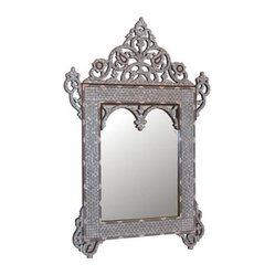 Middle Eastern Artisans - Mother of Pearl Mirror - Mirror, mirror on the wall ... looks like this mirror is the fairest of them all. Mother-of-pearl and bone detailing give this piece an exotic look as if it were salvaged off an ancient Moroccan wall. Place this in your entryway, bathroom or master bedroom for a touch of old-world romance.